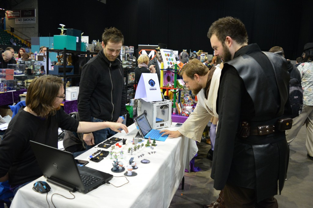 Star Wars cosplayers checking out the table